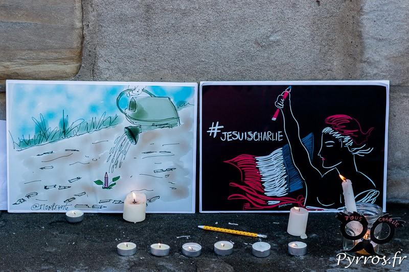 Des bougies devant une Marianne tenant un stylo