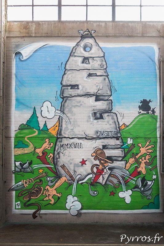 Certains tableaux font référence à la culture populaire, ici une représentation du menhir d'Obelix qui écrase des légionnaires romains